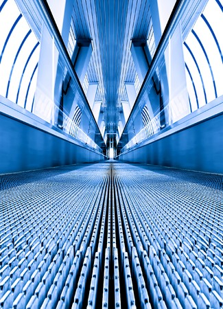 fast moving escalator by motion photo