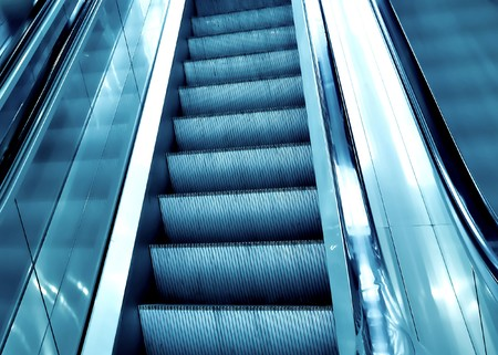 diminishing: diminishing stairway of blue empty business escalator