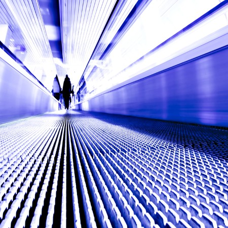 movement of blue abstract escalator with people photo