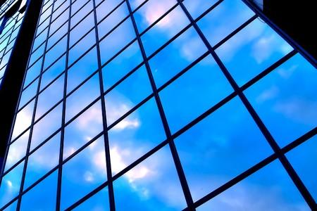 glazed: clouds in glazed panel skyscraper Stock Photo
