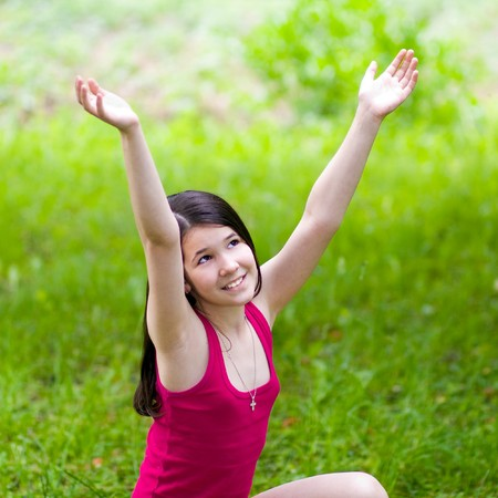 beauty girl with open hands over green grass in sunny day Stock Photo - 7415045
