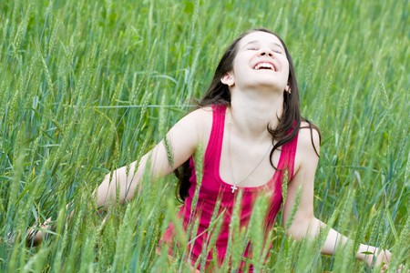 cutie: laughing cutie over field of wheat