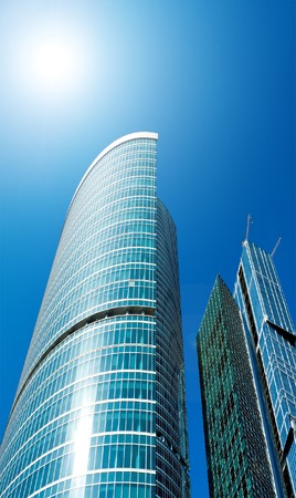 modern glass business center in sunny day photo