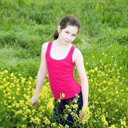 spectacular smile of fresh female face over green grass Stock Photo - 7626770