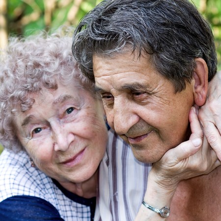 actual gladness of elderly people hugging photo