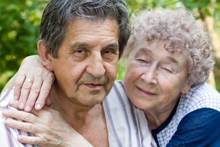 actual: actual gladness of elderly people hugging Stock Photo