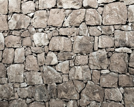 black stones: Background of stone wall texture Stock Photo