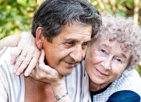 gladness: actual gladness of elderly people hugging Stock Photo