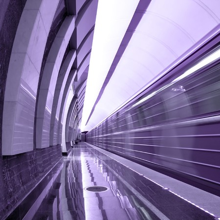 abstract violet station with moving train photo
