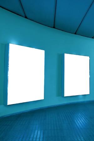 empty frames on blue wall photo