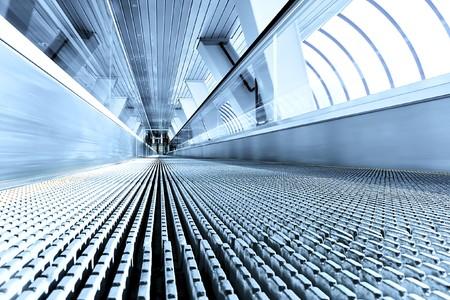 tunnel di luce: escalator movimento veloce  Archivio Fotografico