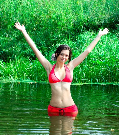 portrait of the sexy brunette girl in nature Stock Photo - 7891696