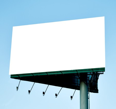 Blank billboard over blue sky photo
