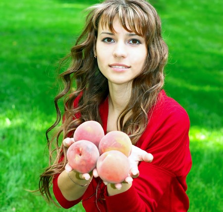beautiful girl with peaches photo