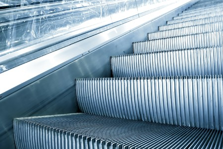blue escalator in motion photo