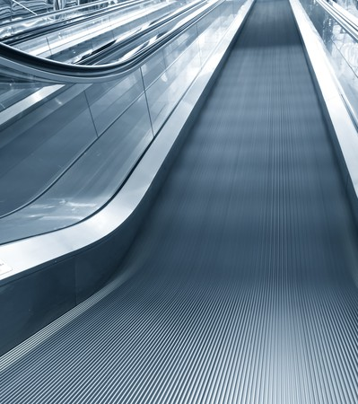 Moving escalator in office center photo