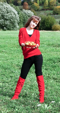 girl with apples in basket on the meadow Stock Photo - 7956614