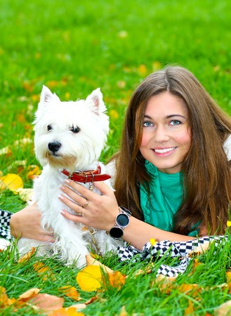portrait of beautiful girl lying with her dog photo