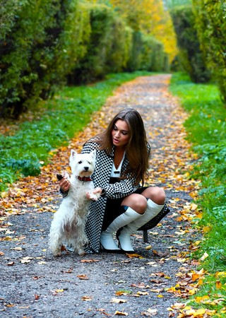 Young girl playing with her dog Stock Photo - 7956611