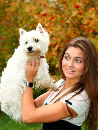 portrait of beautiful girl with her dog Stock Photo - 7956594