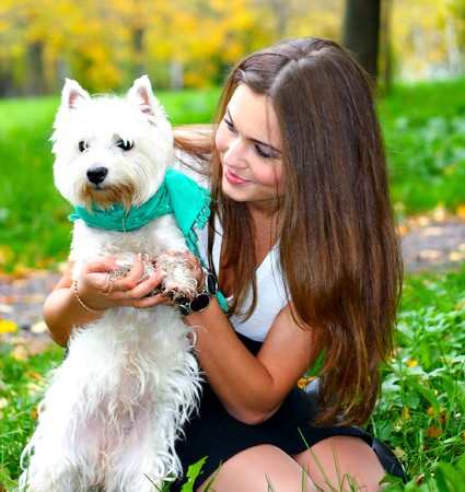 trusting: portrait of beautiful girl with her dog