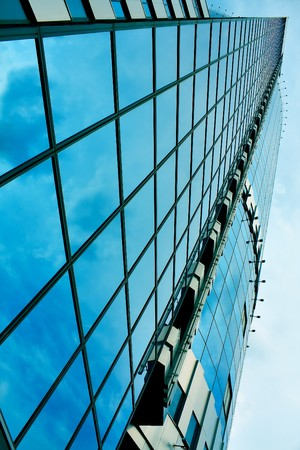 modern green glass skyscraper perspective view Stock Photo - 7891903