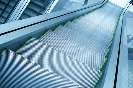 gray steps of escalator in business center photo