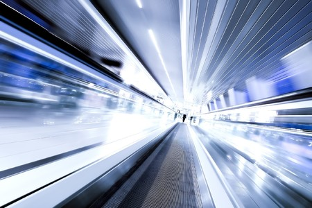 blur subway: high-speed moving escalator