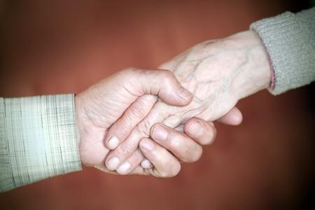 handclasp: handclasp between elderly people Stock Photo