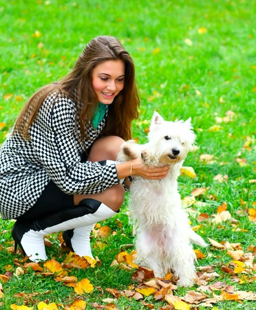 Young girl playing with her dog Stock Photo - 8156601