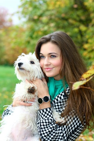 portrait of beautiful girl with her dog Stock Photo - 8156575