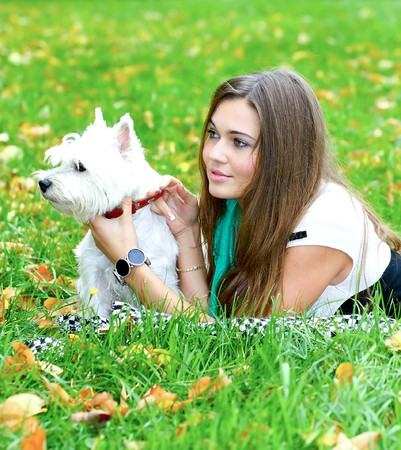 portrait of beautiful girl lying with her dog Stock Photo
