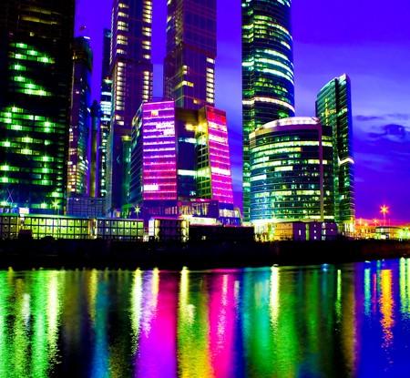 glass illuminated skyscrapers at night photo