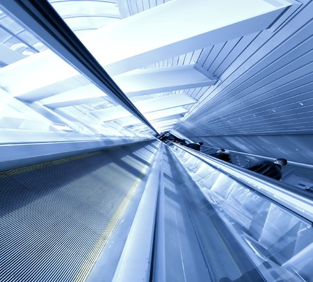 conveyor rail: Escalator in business center Stock Photo