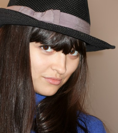 cool sexy girl with beautiful hat looking Stock Photo - 8156586