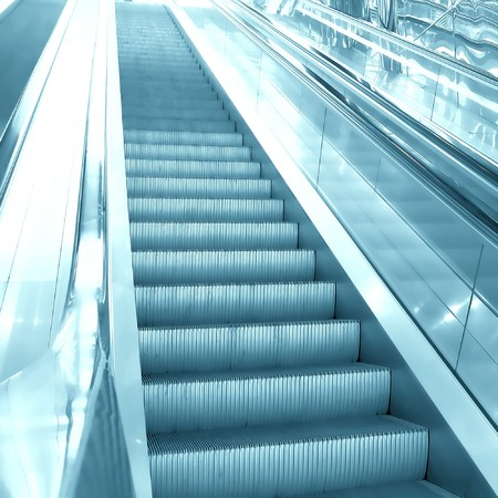 moving escalator in airport photo