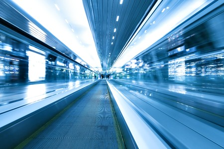 blue motion of business passage, escalator in airport photo