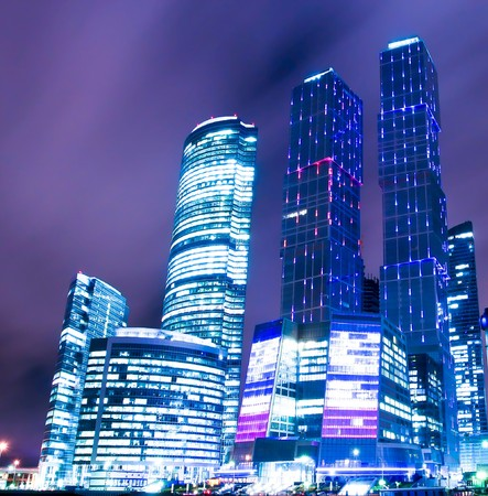 night scene of beautiful illuminated colorful skyscrapers photo