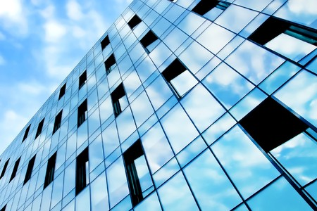 beauty reflection of cloudy sky in modern glass windows photo