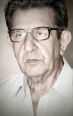 portrait of an elderly man looking seriously photo