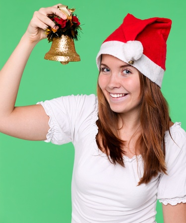 attractive young girl with christmas handbell photo