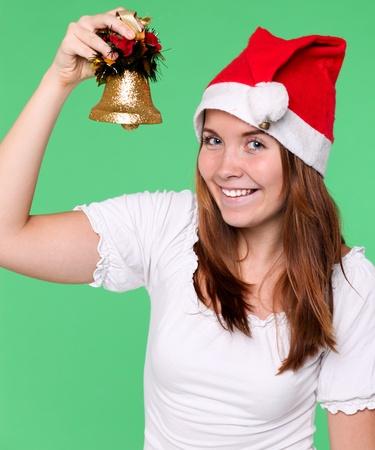 handbell: attractive young girl with christmas handbell