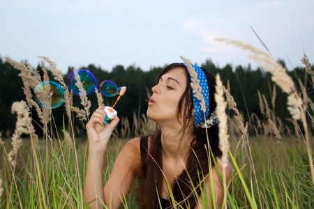 active young girl with soap-bubbles photo