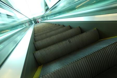 moving escalator inside contemporary airport Stock Photo - 8927412