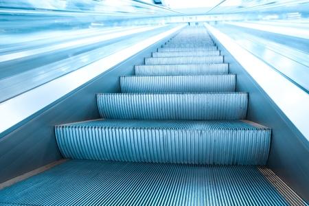 blue escalator in motion photo