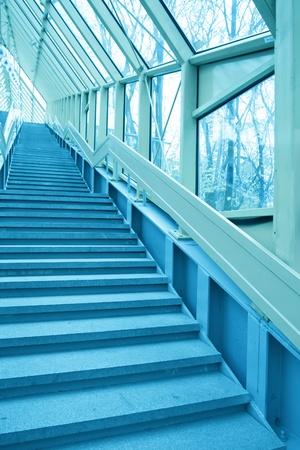 perspective staircase inside yellow corridor photo
