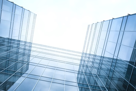 building foundation: disappearing luminosity glass office buildings in the morning, wide angle view Stock Photo