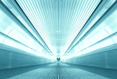 symmetric moving blue escalator inside contemporary airport photo