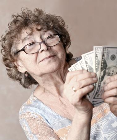 senior happy woman with money photo