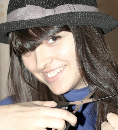 stylish elegant female barber with scissors cutting black hair Stock Photo - 9351918